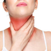 Woman with throat ache touching her throat isolated on white background